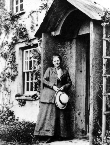 Beatrix Potter at the door of Hill Top, her Lake District home and the setting for many of her delightful children's stories.