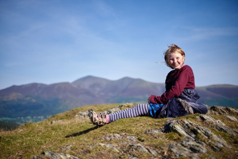 Girl sits on Cat bells