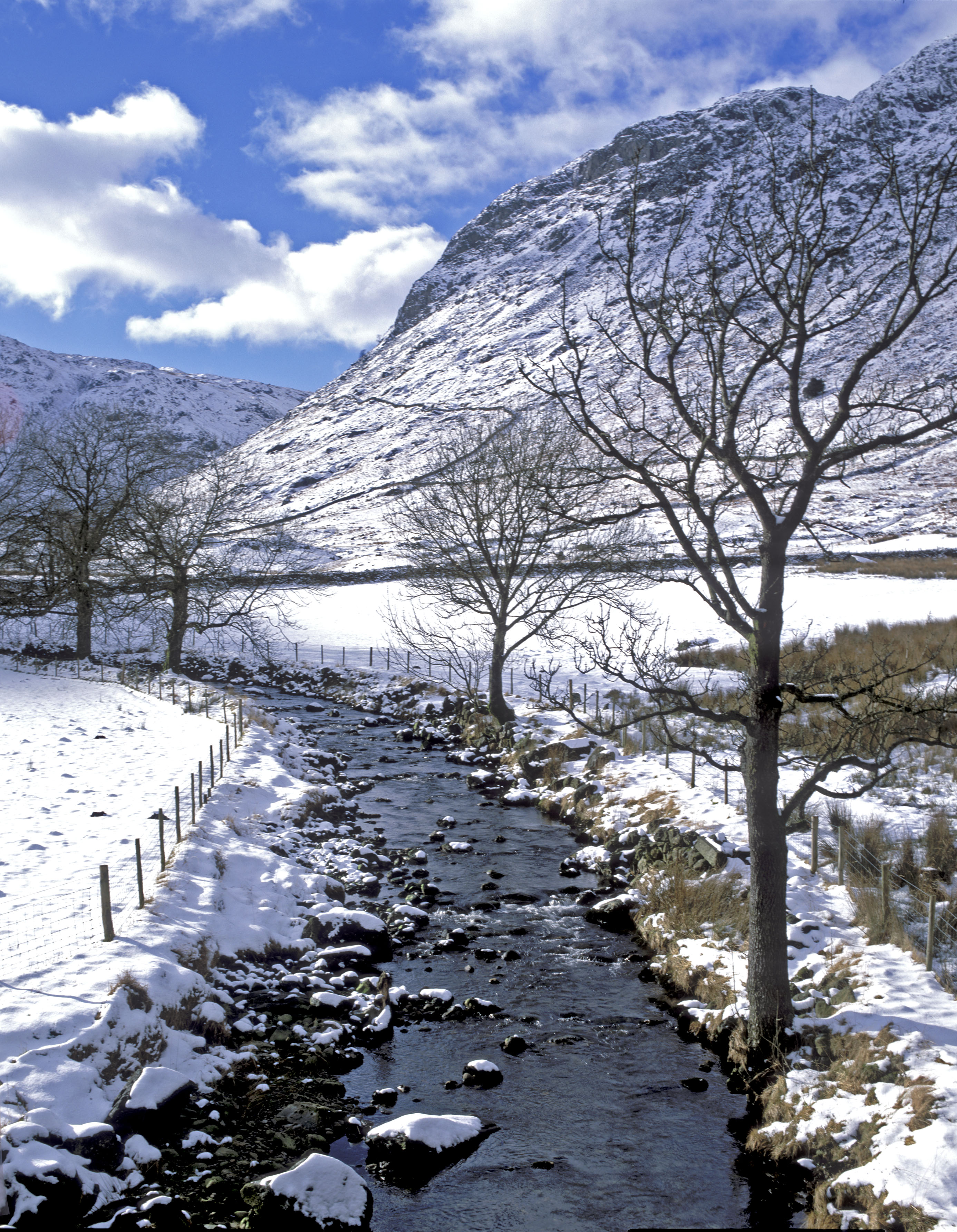 Wyth Burn covered in snow. A snowy scene next to the Southern shore of Thirlmere.